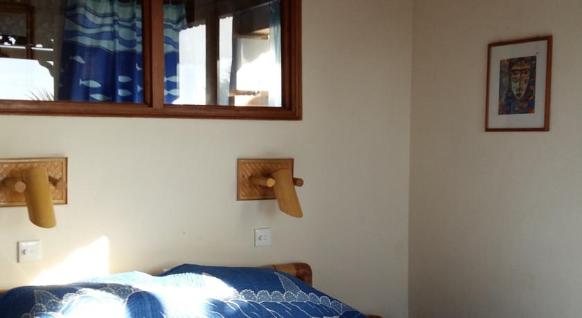 Kamar Tidur di Bayu Cottages