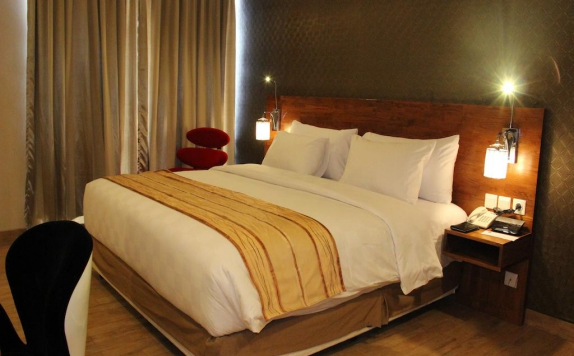 Bedroom di Hariston Hotel & Suites