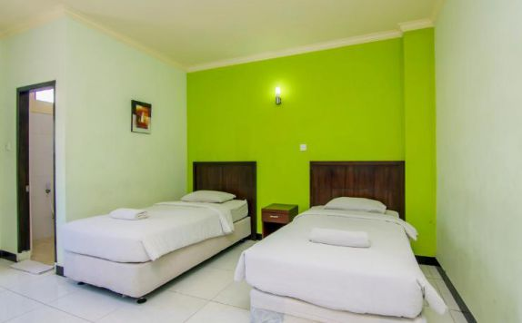 guest room twin bed di Hotel Maria