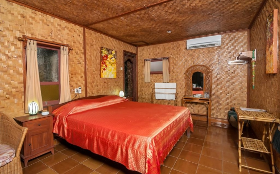 Tampilan Bedroom Hotel di Temple Cafe and Seaside Cottages