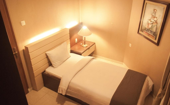 Guest room di Travellers Suites