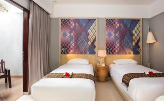 guest room twin bed di ARUNA SENGGIGI RESORT & CONVENTION