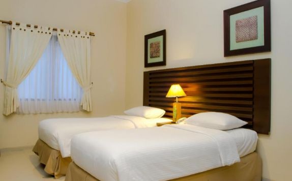 guest room twin bed di Bahamas Hotel & Resort