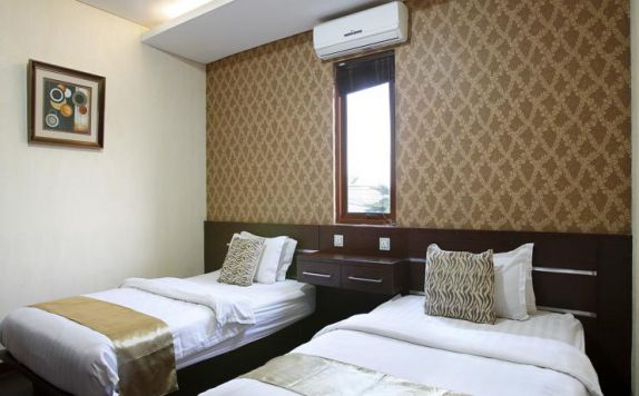 guest room twin bed di Devata Suite and Residence