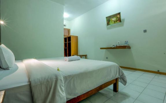 single bed di Giri Putri Hotel Lombok