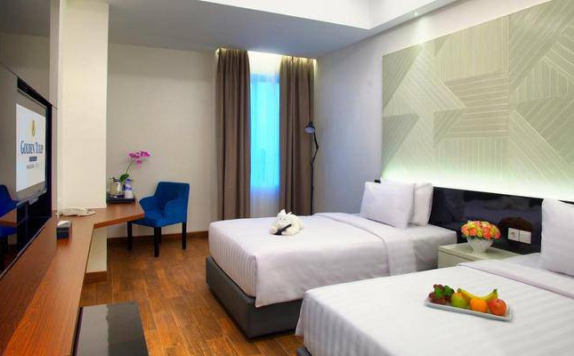 guest room twin bed di Golden Tulip Essential Makassar