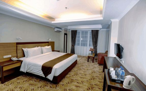 Bedroom di Grand Asrilia Hotel Convention & Restaurant
