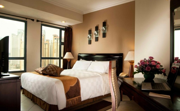Guest room di Grand Tropic Suites