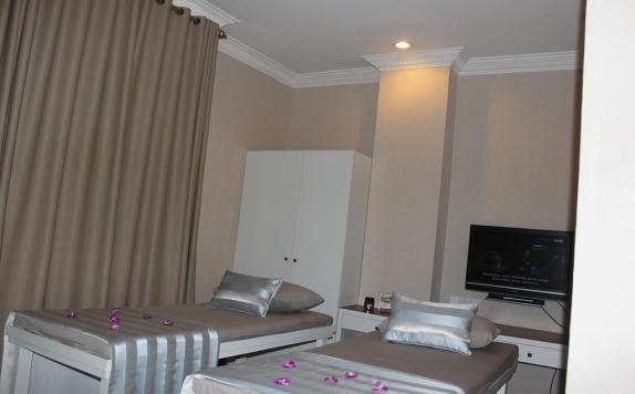 guest room twin bed di Imara Hotel