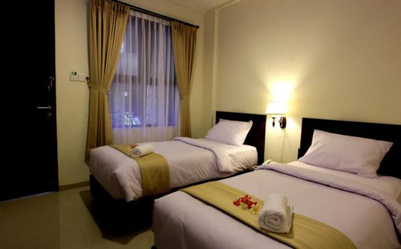 guest room twin bed di Manggar Indonesia