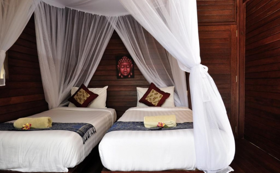 guest room twin bed di Nanuk's Bungalows