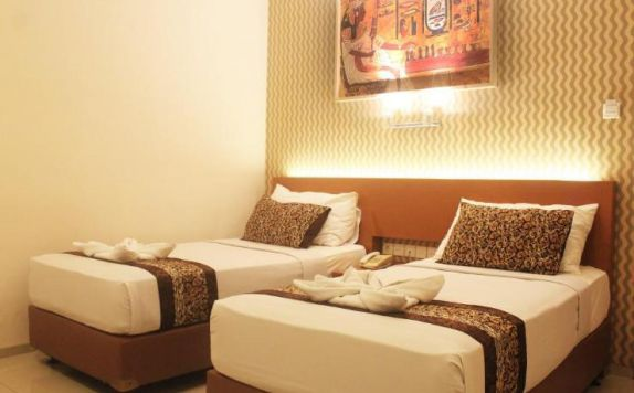 guest room twin bed di Papyrus Tropical Hotel