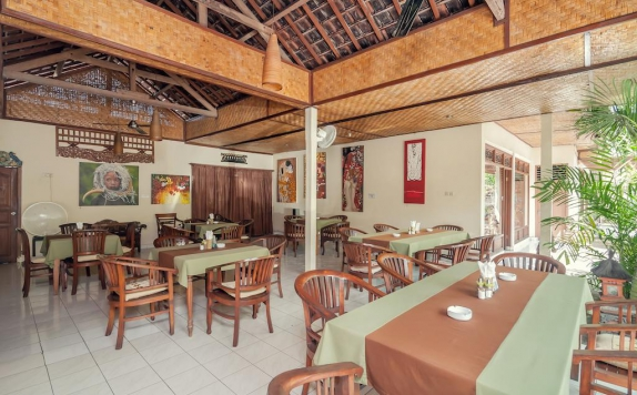 Tampilan Restoran Hotel di Temple Cafe and Seaside Cottages