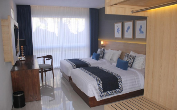 guest room twin bed di The Cakra Hotel