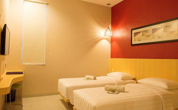 kamar tidur di The Luxe Boutique Guest House