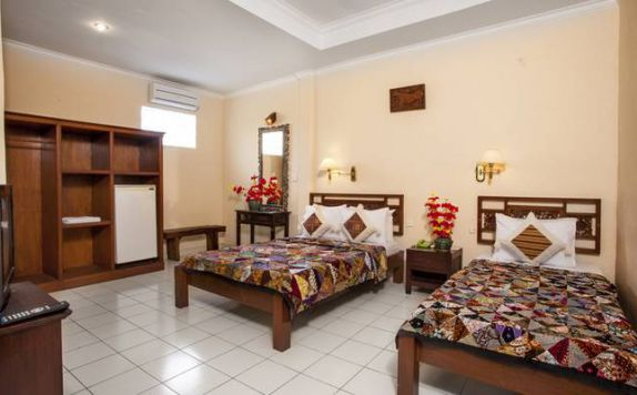 guest room twin bed di Ubud Inn Resort