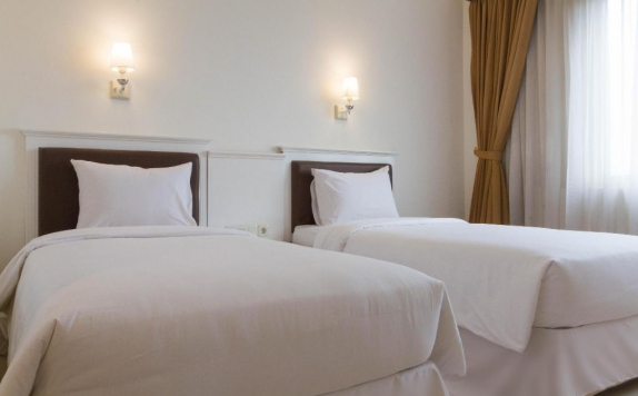 guest room twin bed di Vue Palace Hotel